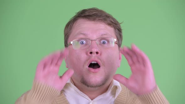 Thumbnail for Face of Happy Overweight Bearded Man Looking Surprised