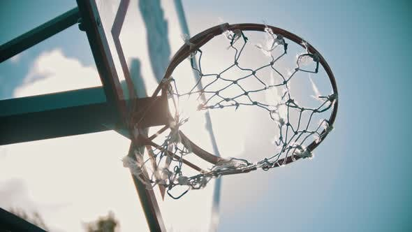 Thumbnail for A Basketball Hoop. The Net Fluttering in the Wind. Bright Sunlight