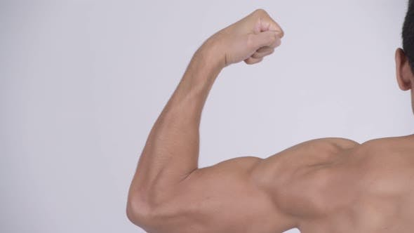 Thumbnail for Head of Young Muscular Shirtless Man Flexing Muscles