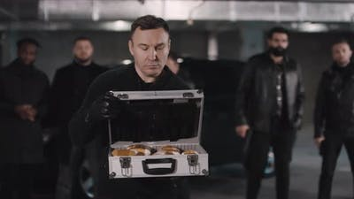 Gangster Opening Briefcase With Drugs