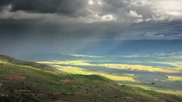 Thumbnail for Storm Clouds and Rain Approaching to Lake Geography Surrounded by Hilly Moorland