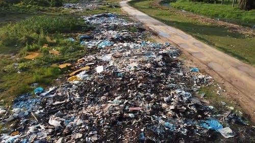 Heap of construction, industrial waste littering roadside