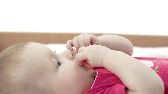 Mom Gives Baby a Pacifier