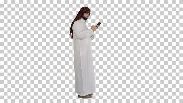 Arab man using his smartphone surfing, Alpha Channel