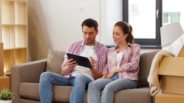 Cover Image for Happy Couple with Tablet Pc Computer at New Home
