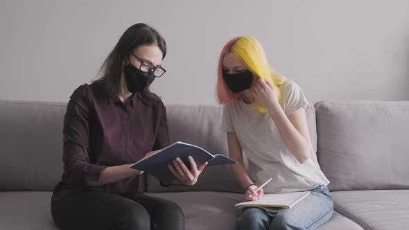 Thumbnail for Teacher Working with College Student Individually, Woman and Teenage Girl in Black Protective Masks