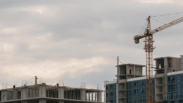 Thumbnail for Building Construction. Tower Crane on a Construction Site. Builders Work. Timelapse
