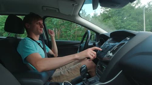 Man Switches Radio In The Car Slow Motion