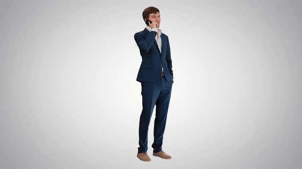 Thumbnail for Handsome Young Businessman Talking on the Phone on Gradient Background