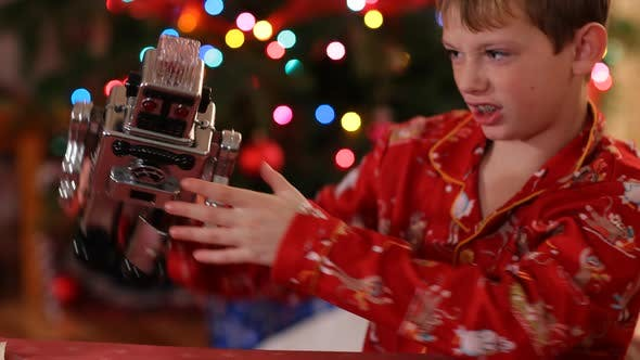 Thumbnail for Boy playing with toy robot on Christmas