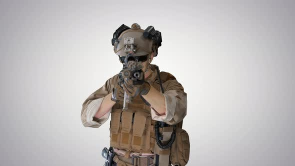 United States Ranger Aiming with Assault Rifle While Walking on Gradient Background