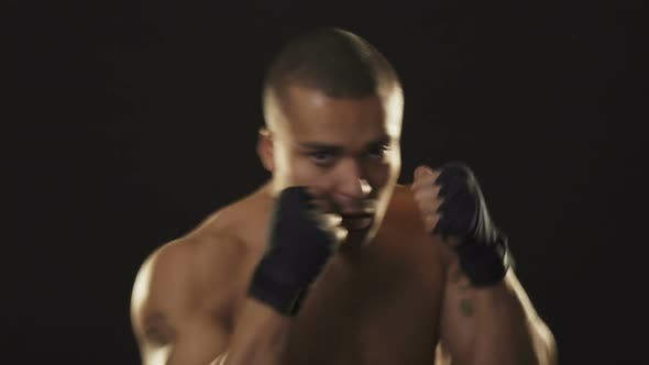 Thumbnail for Young Handsome African Fighter Shadow Boxing on Black Background