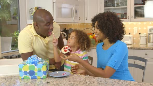 Thumbnail for African American family  having birthday celebration