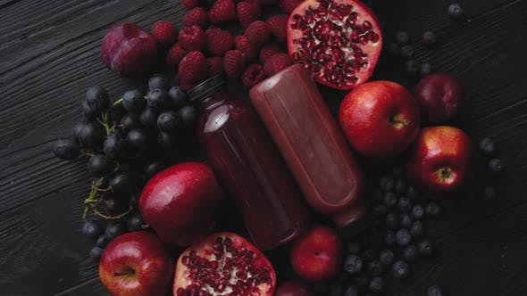 Thumbnail for Various Fresh Red, Purple Black Fruits. Mix of Fruits and Bottled Juices on Black
