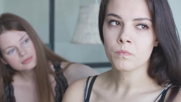 Thumbnail for Close-up of Furious Lesbian Woman with Angry Facial Expression Looking Back at Partner Trying To