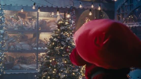 Thumbnail for Happy Santa Claus Walking Quietly Near Christmas Tree