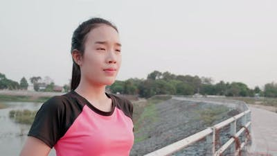 Young woman in sportswear looks at camera and smile.