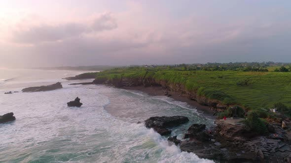 Thumbnail for Flying Over A Beautiful Ocean Of Cliffs And A Beach With Black Volcanic Sand