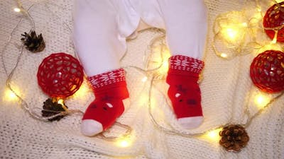 Baby Feet In Funny Christmas Socks