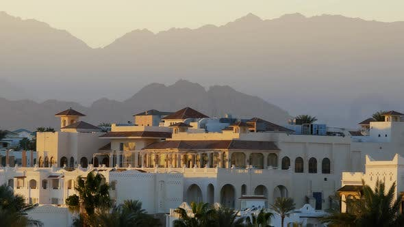 Panoramic View of Luxury Resort Hotel Apartment with Balcony and Palm Near Beach. Mountains on