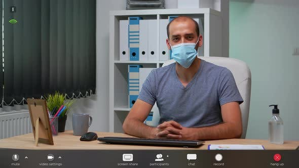 Thumbnail for Freelancer Talking at Camera with Prrotection Face Mask