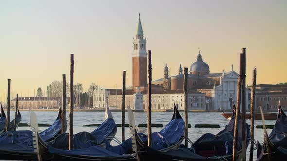 Thumbnail for Covered Gondolas Swaying on Water Against a Beautiful Venice View