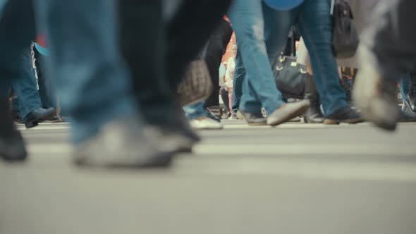 Thumbnail for People Pedestrians Walks Across a Busy City Street
