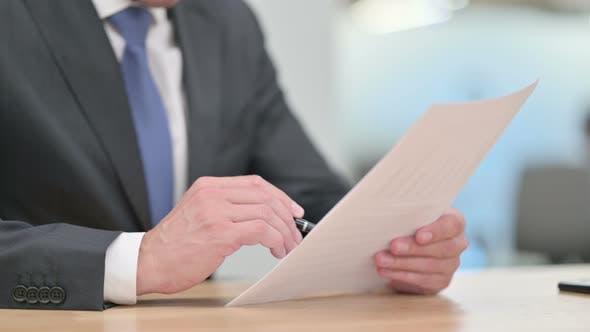 Businessman Reading Documents, Paperwork