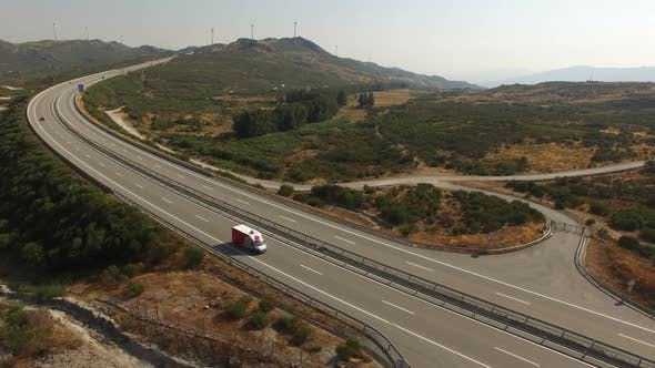 Thumbnail for Traffic on a Highway in the Summer Near Wind Turbines in the Mountains