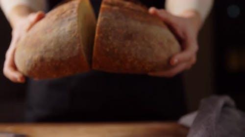Female Baker Showing Homemade Bread at Bakery