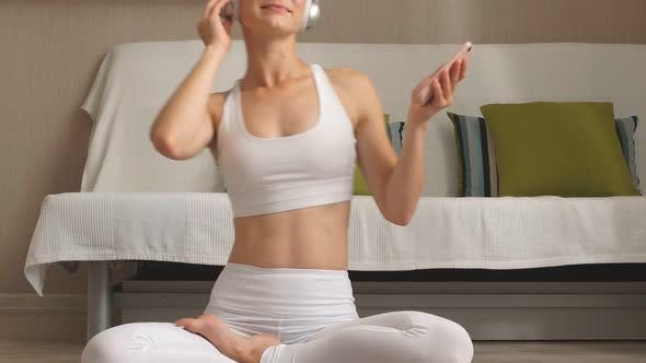 Thumbnail for Beautiful, Slim Woman Sit with Smartphone and Headphones, Listening Music.