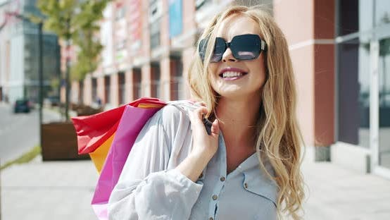 Thumbnail for Happy Woman with Shopping Bags