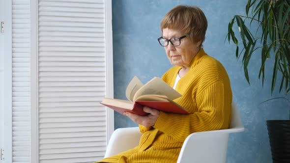 Thumbnail for Senior Woman Reading A Book Relaxing At Home.