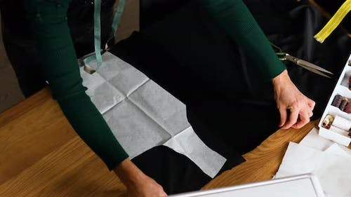 Step by step, Woman dressmaker making sewing patterns
