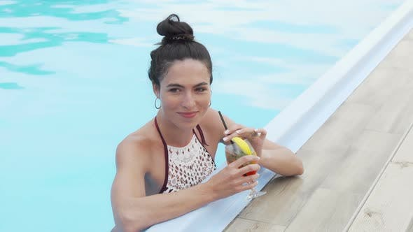 Thumbnail for Beautiful Happy Woman Enjoying Cocktail at the Swimming Pool