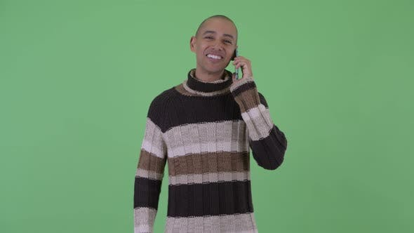 Thumbnail for Happy Bald Multi Ethnic Man Talking on the Phone Ready for Winter