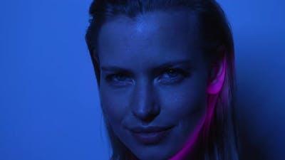 Moving Pink Light on Blonde Models Face