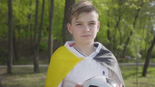 Thumbnail for Portrait of a Little Adorable Boy Holding a Soccer Ball. Outdoor Recreation