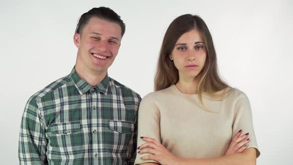 Thumbnail for Cheerful Handsome Man Laughing at His Annoyed Girlfriend, Isolated