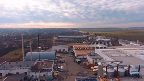 Solar energy farm. Aerial view of factory roof with solar panels