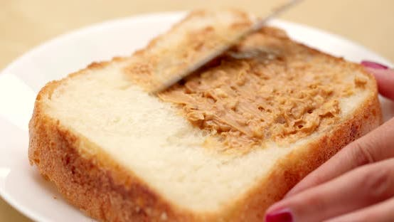 Thumbnail for Apply peanut butter on white bread for breakfast