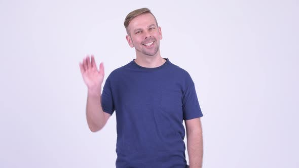 Cover Image for Portrait of Happy Blonde Man Smiling and Waving Hand