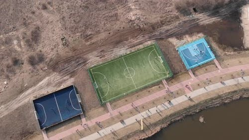 Modern sport playground with football and basketball fields