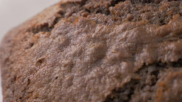 Thumbnail for Shiny choco cake glazed surface close-up cracks after baking panning  4K 2160p 30fps UltraHD video -