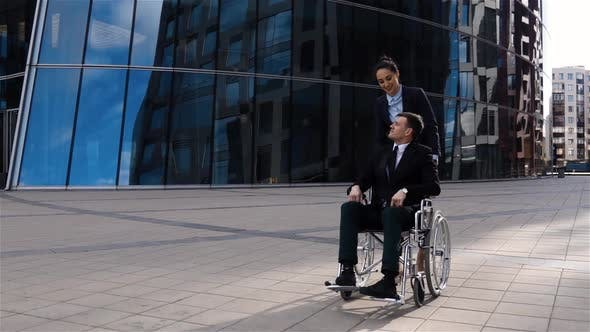 Thumbnail for Handsome Businesswoman Cares for His Colleague in Wheelchair