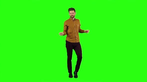 Thumbnail for Man Is Dancing Energetically, He Is Having Fun. Green Screen. Slow Motion