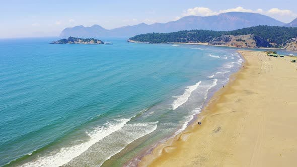 Thumbnail for Beach on the Mediterranean Sea. Spit Iztuzu Shares the Sea and the River Dalyan. People Walk on the