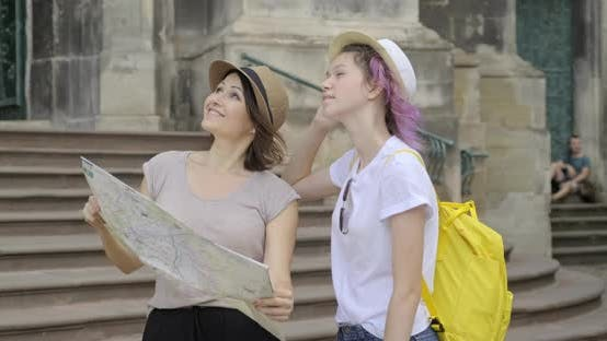 Thumbnail for Mother and Teenage Daughter in Old Tourist City with Map
