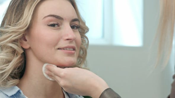 Cover Image for Make-Up Artist Cleaning Skin on Model Face