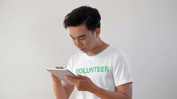 Thumbnail for Male Volunteer with Tablet